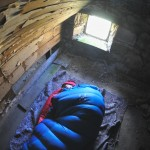 Steve Peat sleeping in a Scottish bothy