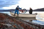 Steve Peat putting his bike in a boat