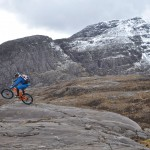 Steve Peat wheelying in the Scottish Highlands