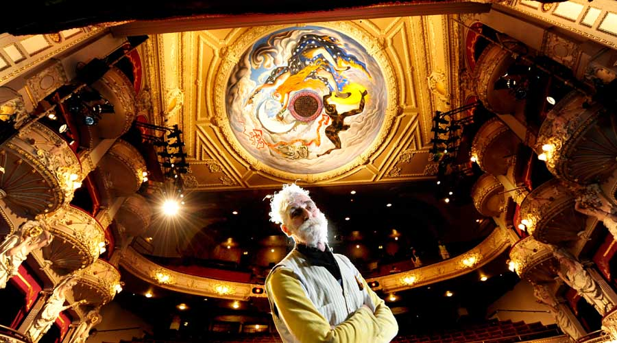 Artist John Byrne stands beneath his mural 'All the world's a stage' © Colin Hattersley