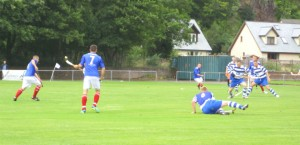 Newtonmore valiantly defend against Kyles in a cup final shinty match