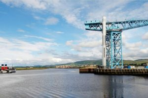 The Titan Crane stands on the banks of the River Clyde as the Paddle Steamer Waverley passes by