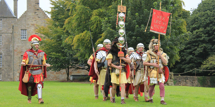 A small re-enactment of Romans marching with flags