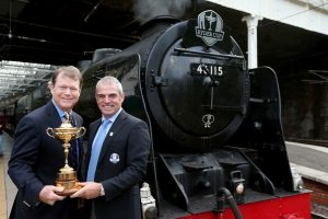 Ryder Cup captains Tom Watson (left) and Paul McGinley with the iconic trophy ahead of travelling on their specailly commisioned steam train from Edinburgh to Gleneagles to take part in the Year to Go countdown celebrations