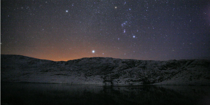 looking over the loch to hills, with stars in the sky