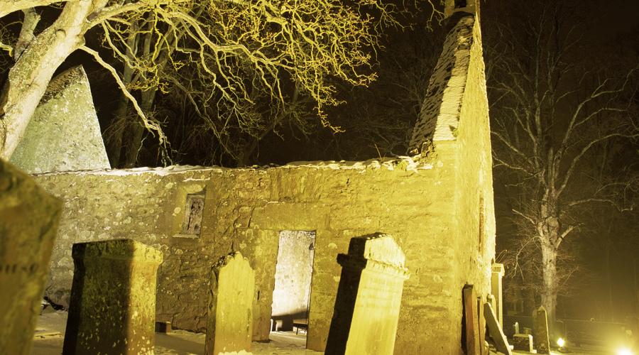 The atmospheric Alloway Kirk floodlit at night , Ayrshire.