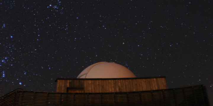 Looking up to the round dome of the observatory and the stars beyond