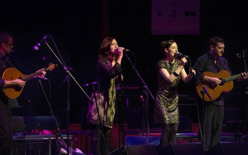 Fowlis and her band performing at the 20th celebration opening concert, held in the festival's main venue. The Glasgow Royal Concert Hall