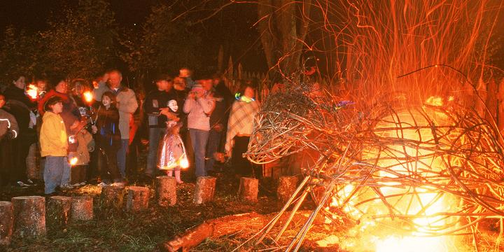 A crowd gathered around a bonfire at the Samhain festival on Loch Tay
