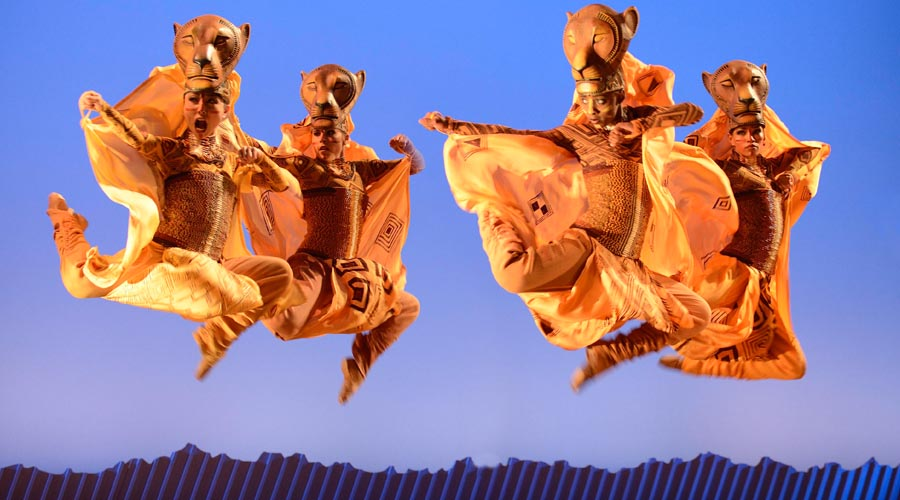 Dancers recreate the African plains in The Lion King