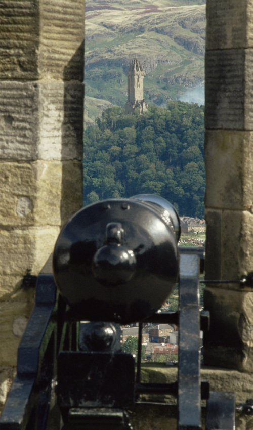 The view from a cannon at Stirling Castle, looking across to the Wallace Monument and Ochil Hills beyond