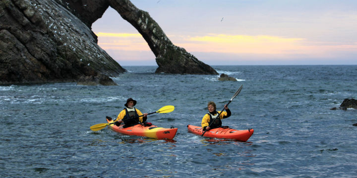 Sea kayaking at Bow Fiddle Rock, Moray