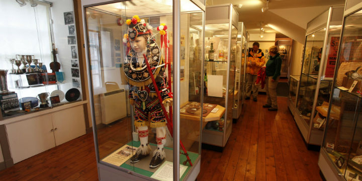 Tourists look at displays in the Orkney Museum, in Kirkwall
