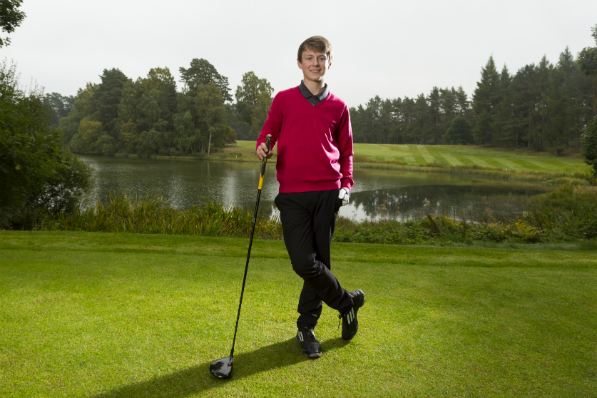 Junior golfer Lewis Breslin standing with a club at Blairgowrie Golf Club