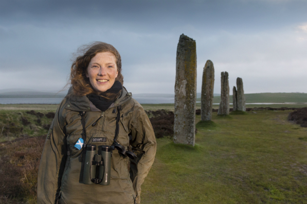 Wildlife ranger Jenny Campbell standing at the Ring of Brodgar