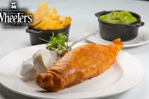Fish, chips and mushy peas as served at Wheeler's of St James's, Dumfries