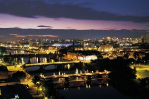 View over the bridges of the River Clyde towards the city of Glasgow, lit up at night