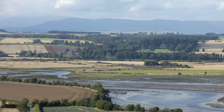 The view over fields towards the Montrose Basin with the House of Dun visible beyond, Angus