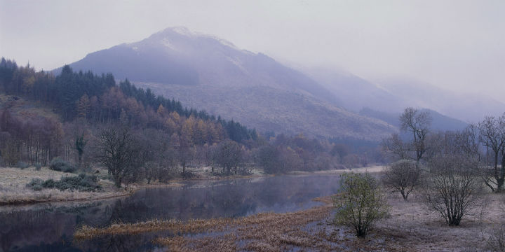 View of Loch Lubnaig in the Trossachs National Park, with snowy mountains beyond