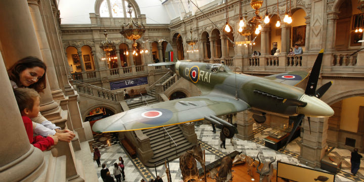 Family looking at the Spitfire at the Kelvingrove Art Gallery and Museum, Glasgow