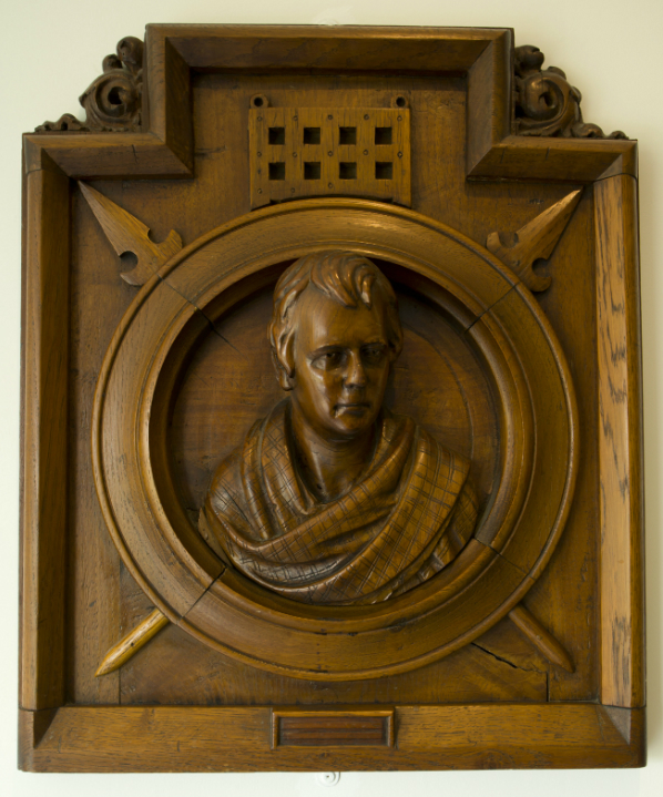A wooden carving of Sir Walter Scott from the Visitor Centre at Abbotsford - the home of Sir Walter Scott, near Melrose, Scottish Borders