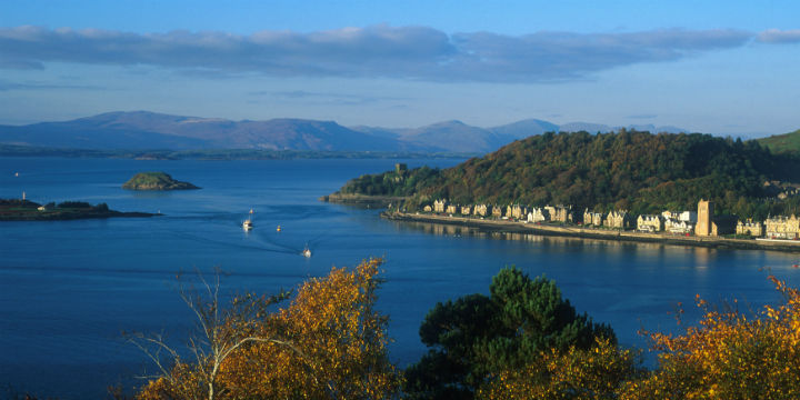 Looking over Oban bay to an ivy-clad castle and islands in the disctance