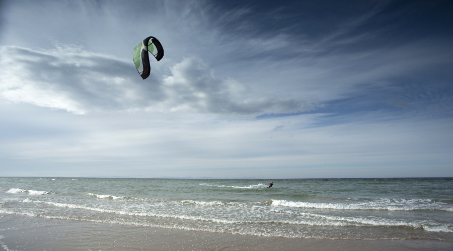 Kite surfer enjoying spectacular winds at Findhorn Beach, Moray
