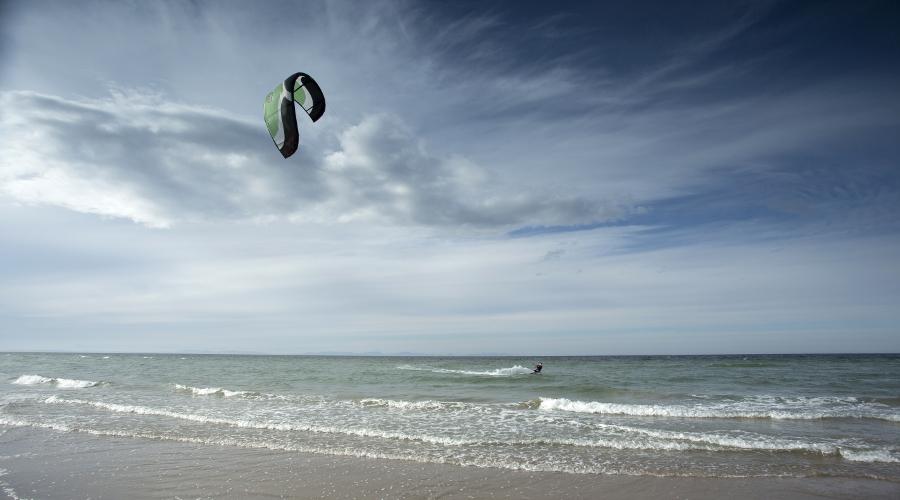 Kite surfer enjoying spectacular winds at Findhorn Beach, Moray