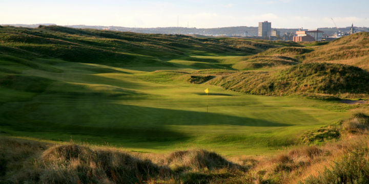 looking across the undulating links course, with the city in the distance.