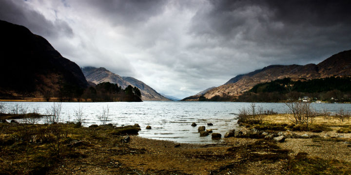 Looking along Loch Shiel with dramatic mountains either side.
