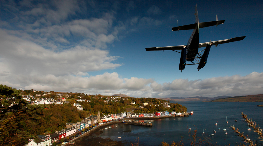 The Loch Lomond seaplane flies into Tobermory on the Isle of Mull