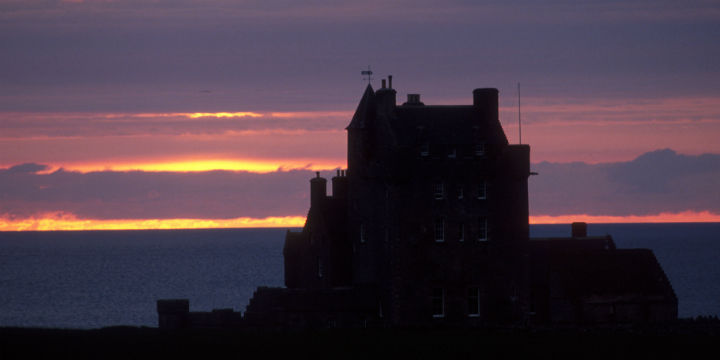 Looking over to the sillhouette of Ackergill Tower at sunrise.