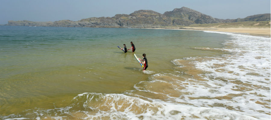 Children bodyboarding at Kiloran Bay, Isle of Colonsay