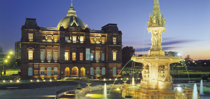The People's Palace at dusk. with the restored Doulton Fountain in the foreground, in Glasgow