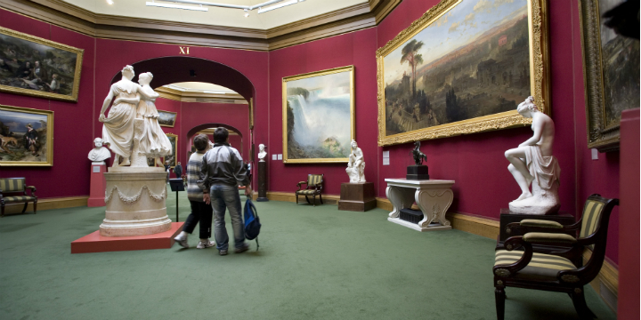 Visitor look upon pictures in the National Gallery of Scotland, Edinburgh