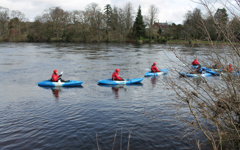 Three kayakers set off an a kayaking trip down the River Tay