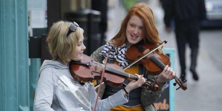 Musicians busking in Kirkwall
