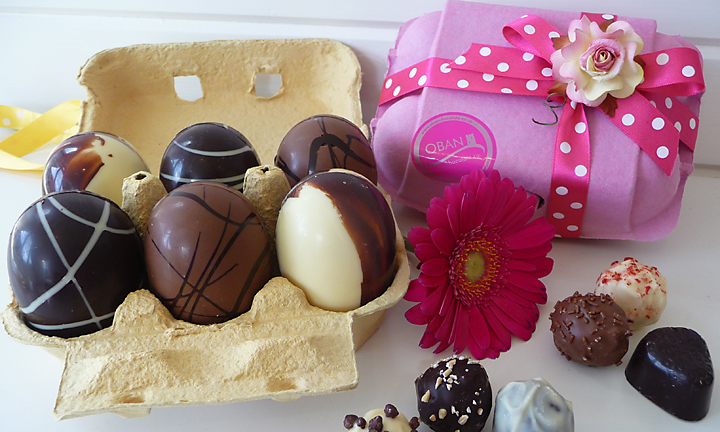 Sic chocolate eggs displayed in an egg carton.