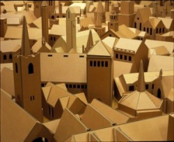 Model churches made from cardboard are displayed very close together