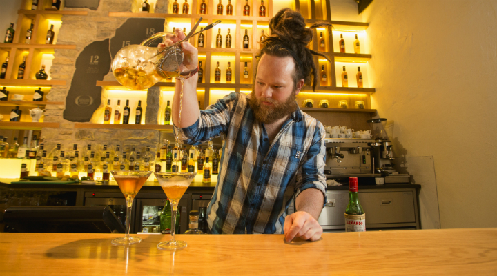Barman at Glenfiddich's Malt Barn mixes some whisky cocktails