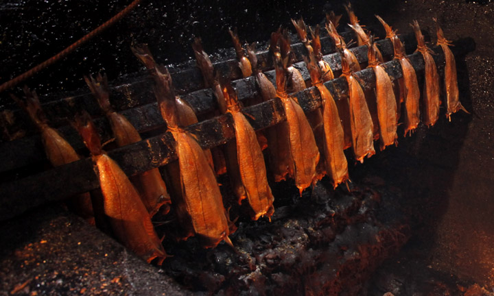 The fish are hung over heat during the smoking process