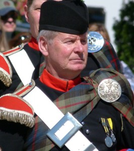 Pipe Major Ian Duncan in the dress of the Atholl Highlanders