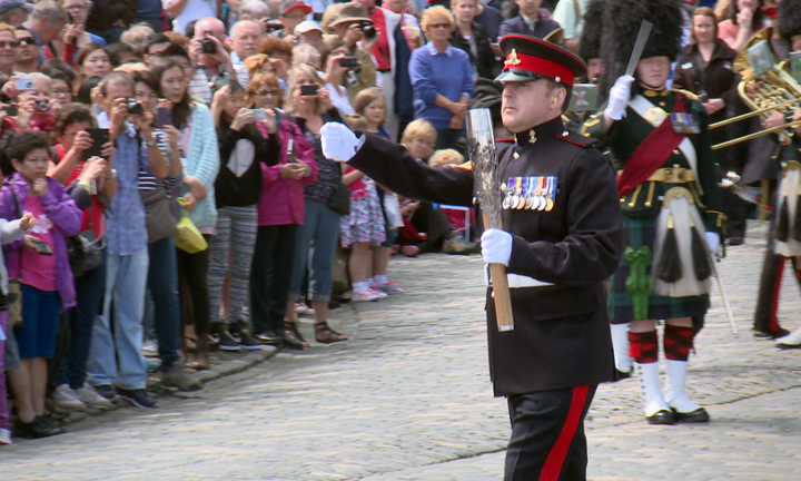 Sergeant David Beveridge marches with the baton through Edinburgh Castle