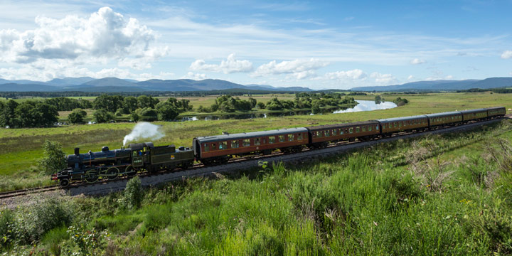 The EV Cooper, Engineer steam train (one of the Strathspey Steam Railway locomotives) on the track between Aviemore and Broomhill near Boat of Garten