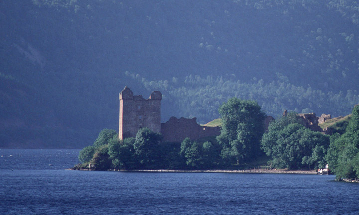 Looking across the bay at Drumnadrochit to the ruins of Urquhart Castle by Loch Ness.