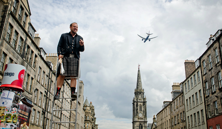 A kilted street performer on the Royal Mile during the Edinburgh Festival