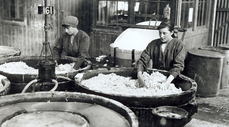 Munitions workers unloading the nitrating pans in the factory