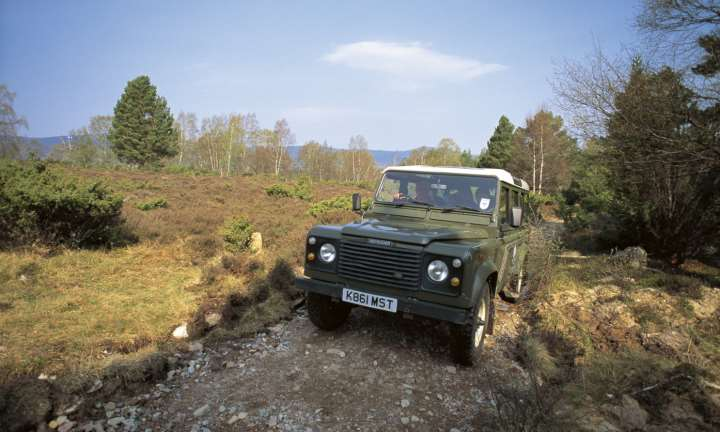 A Landrover negotiates a track on a Landrover safari on the Rothiemurchas Estate near Aviemore
