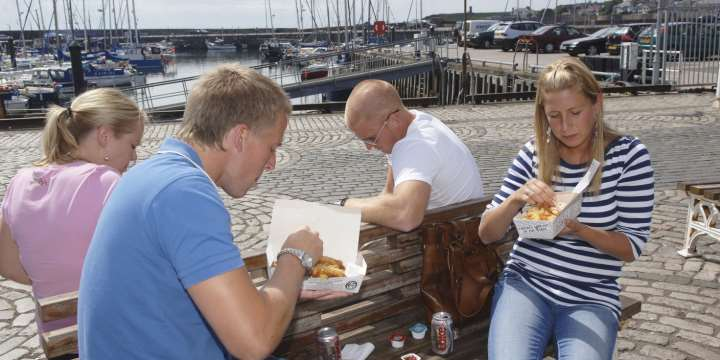 Enjoying fish and chips at the harbour front at Anstruther, East Neuk of Fife