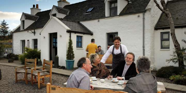 Head chef Michael Smith with guests outside The Three Chimneys Restaurant, Colbost, Isle of Skye